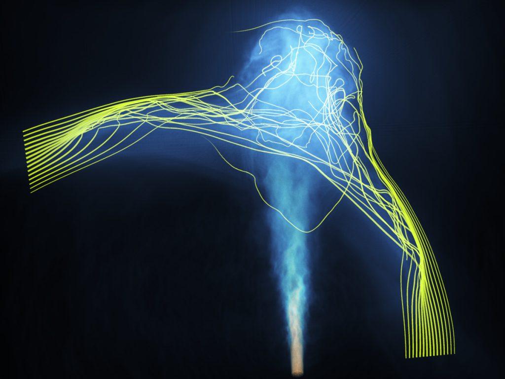 シミュレーションの1場面。黄色い線は磁場を表しています。クレジット:大村匠、町田真美、中山弘敬、国立天文台4次元デジタル宇宙プロジェクト